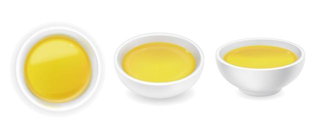 Реалистичное оливковое или подсолнечное масло в круглом наборе для соуса. желтый жидкий мед, изолированные на белом фоне. еда иллюстрация Premium векторы