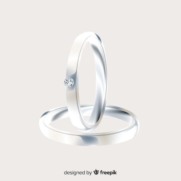 Realistic pair of silver wedding rings Free Vector