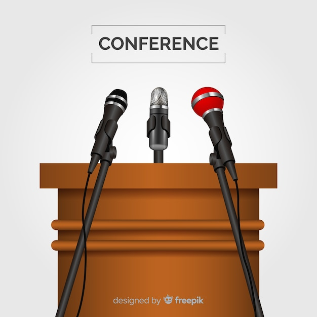 Realistic podium with microphones for conference Free Vector