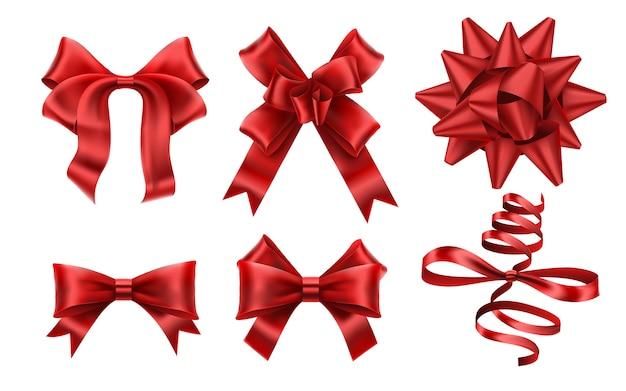 リアルな赤い弓。装飾的なクリスマスギフトリボンの弓、クリスマスまたはロマンスの装飾要素。 Premiumベクター