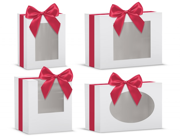 Realistic set of empty gift boxes with red silk bows and with transparent windows isolated Free Vector