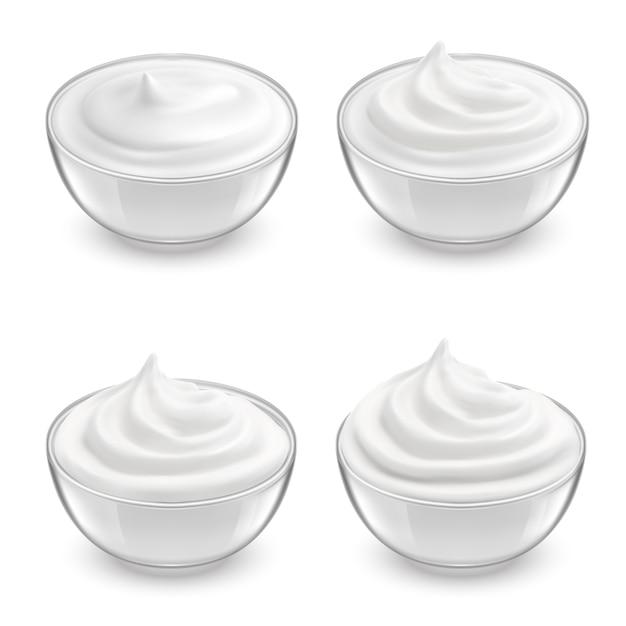 Realistic set of transparent bowls with white sour cream, mayonnaise, yogurt, sweet dessert. Free Vector