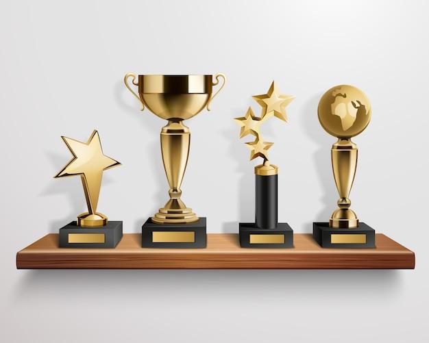 Realistic shiny golden trophy awards on wooden shelf on grey background vector illustration Free Vector