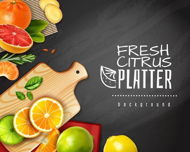 黒板に現実的なスライスした柑橘系の果物 無料ベクター