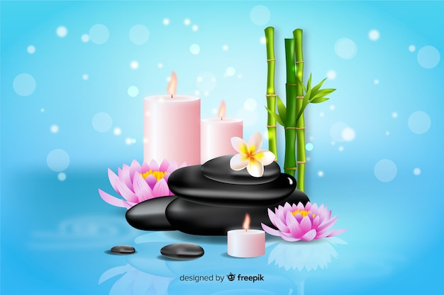 Realistic spa background with candles and bamboo Free Vector