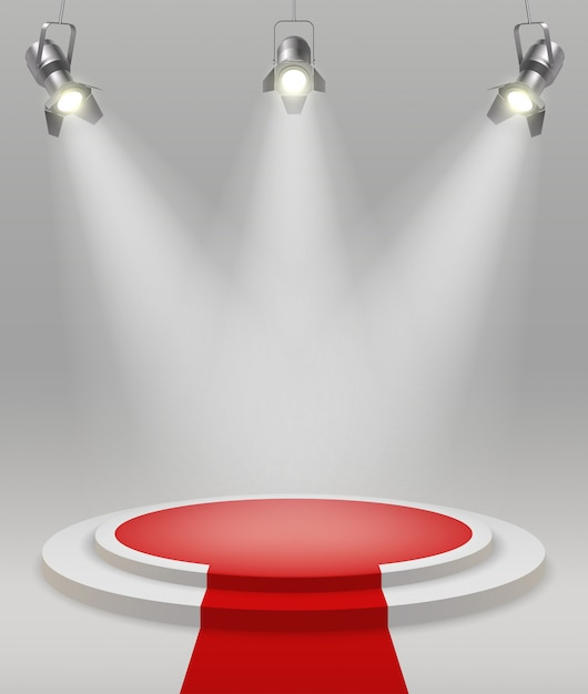 Realistic stage with spotlights red carpet in the middle of the room vector illustration Free Vector