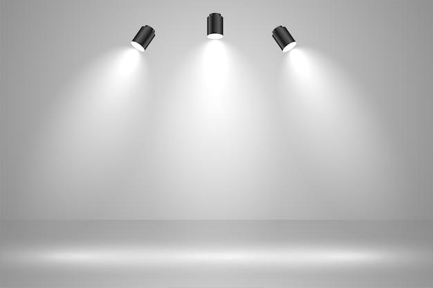 Realistic studio lights empty background design Free Vector