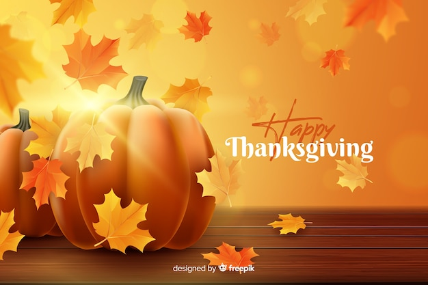 Realistic thanksgiving background with dried leaves Free Vector