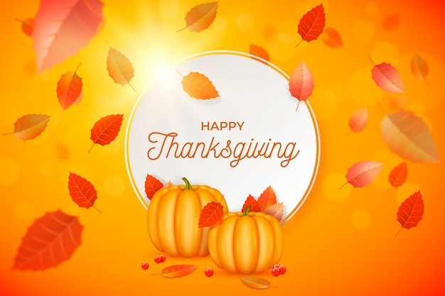 Realistic thanksgiving background with leaves and pumpkins Free Vector