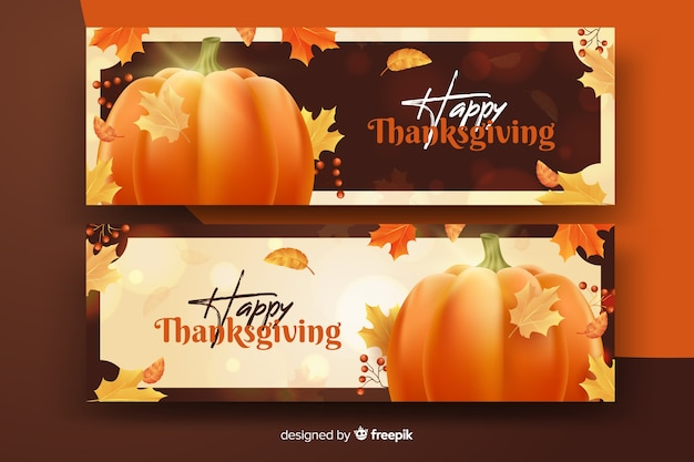 Realistic thanksgiving banners with pumpkin and dried leaves Free Vector