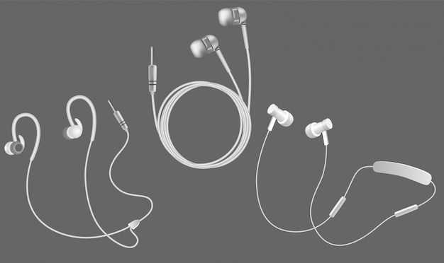 Realistic white headphones icon set Premium Vector