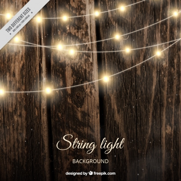 Realistic Wooden Background With String Lights Free Vector