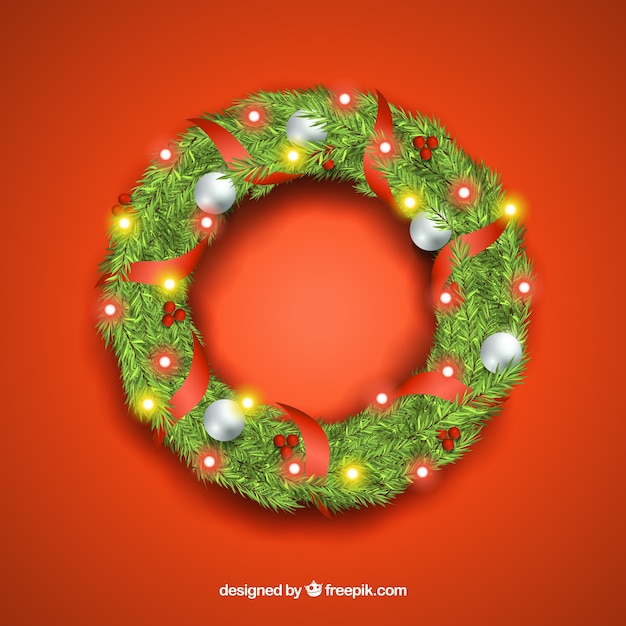 Realistic wreath decorated with christmas lights