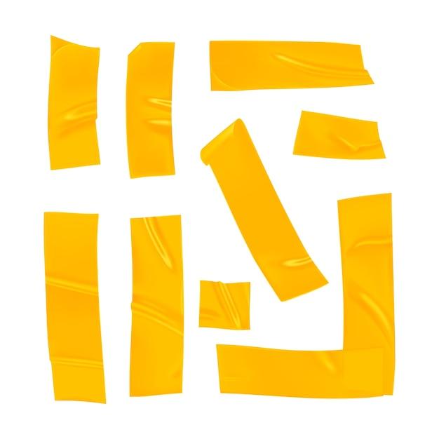 Реалистичные желтые кусочки скотча для крепления на белом фоне. Premium векторы