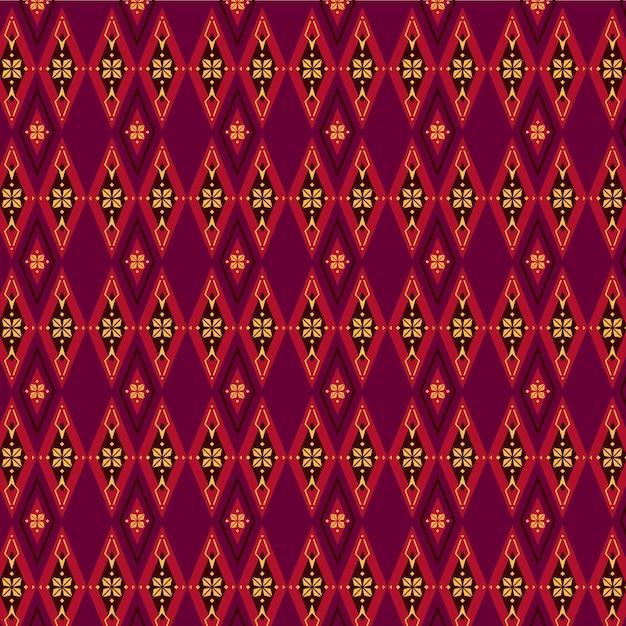 赤と茶色のソンケットパターン Premiumベクター