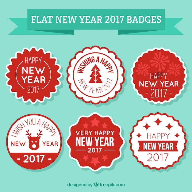 red and white labels for the new year free vector