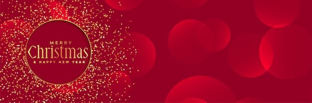 Sfondo rosso con glitter dorati per il festival di natale Vettore gratuito