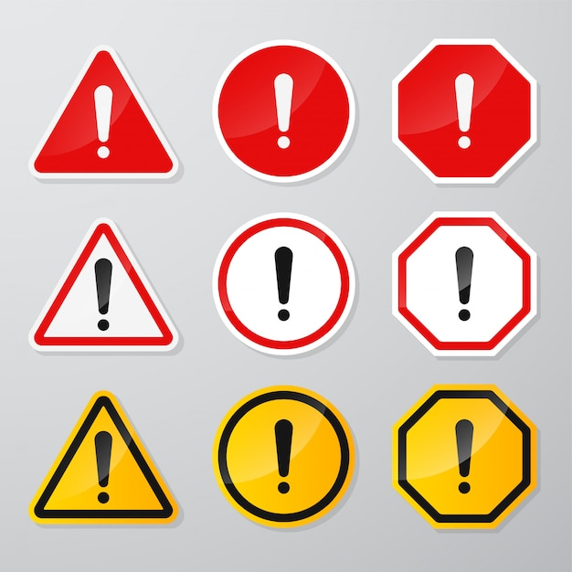 Red and black danger warning sign   with the exclamation mark in the middle Premium Vector