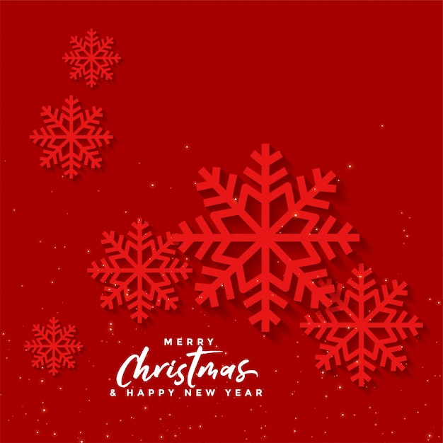 Red christmas background with snow flakes Free Vector