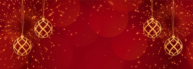 Red christmas banner with sparkles and golden balls Free Vector