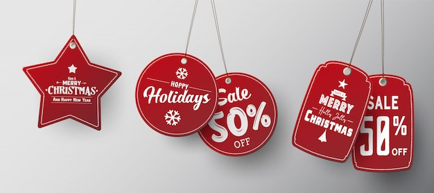 Red christmas sale paper tags set with different shapes. Premium Vector