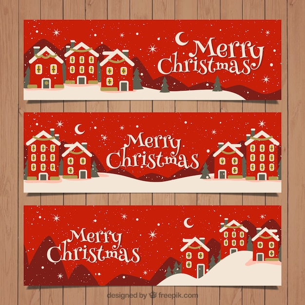 Red christmas village banners in vintage style Free Vector