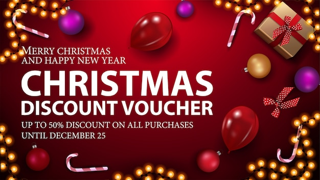 Red christmas voucher with present, candy canes, christmas balls, balloons and garland, top view Premium Vector