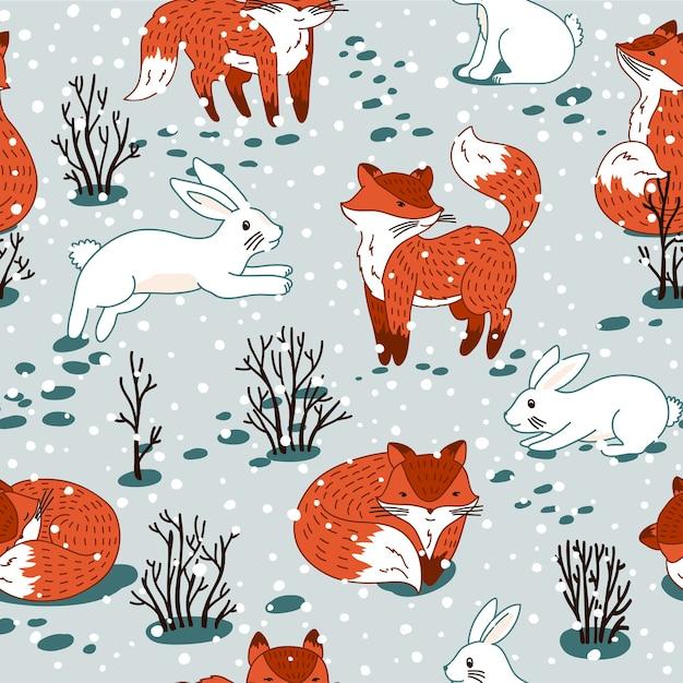 森の赤狐と白うさぎ。野生の森の動物とのシームレスなパターン。冬のクリスマスイラスト。 Premiumベクター