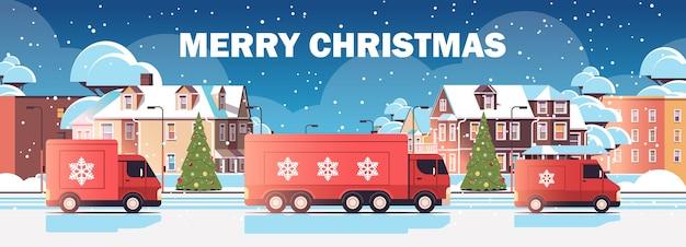 ギフトを配達する赤いトラックトラックメリークリスマス新年あけましておめでとうございます冬の休日お祝い速達サービスコンセプト都市景観背景水平ベクトル図 Premiumベクター