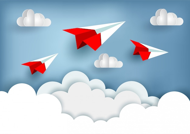 Red paper plane up to the sky while flying above a cloud Premium Vector