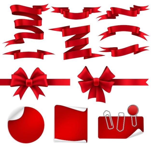 赤いリボンとギフトの弓。クリスマス割引オファーのためのシルク装飾光沢テープバナー、ラベル、ステッカー。リアルなホリデープレゼントデコレーションセット Premiumベクター