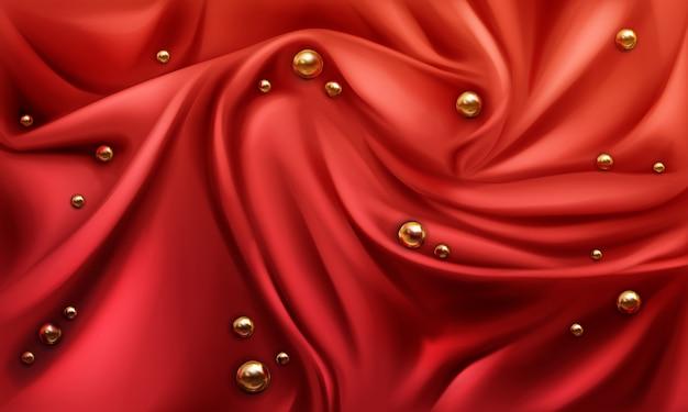 Красный шелковый драпированный фон с золотыми беспорядочно разбросанными блестящими шарами или жемчужинами. Бесплатные векторы
