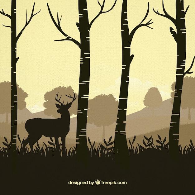 Reindeer between trees silhouettes background Free Vector