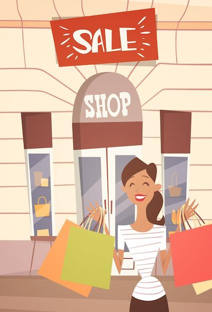 買い物袋を持つ漫画女性ビッグセールバナーretial store exterior Premiumベクター