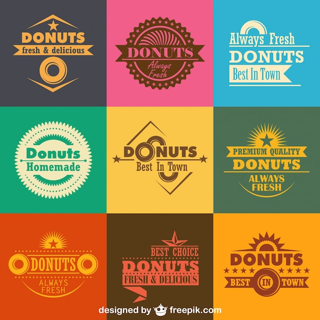 Retro donuts logos and badges collection Premium Vector