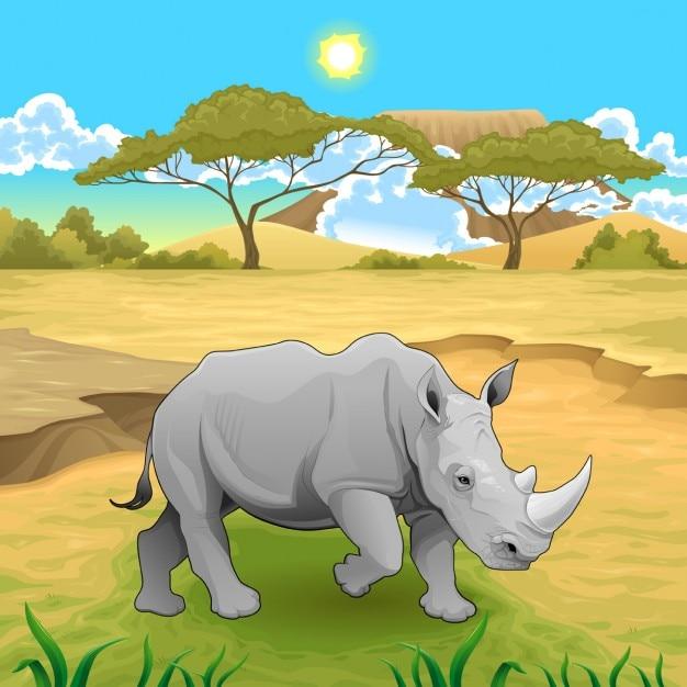 A rhino in the savannah Free Vector