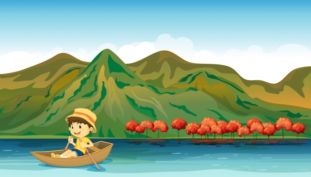 A river and a smiling boy in a boat Free Vector