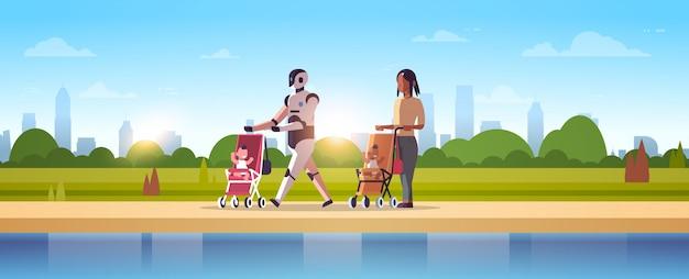 Робот-няня и мать гуляют с ребенком в коляске робот против человека, стоящего вместе технология искусственного интеллекта концепция городской парк пейзаж полная длина горизонтальный Premium векторы