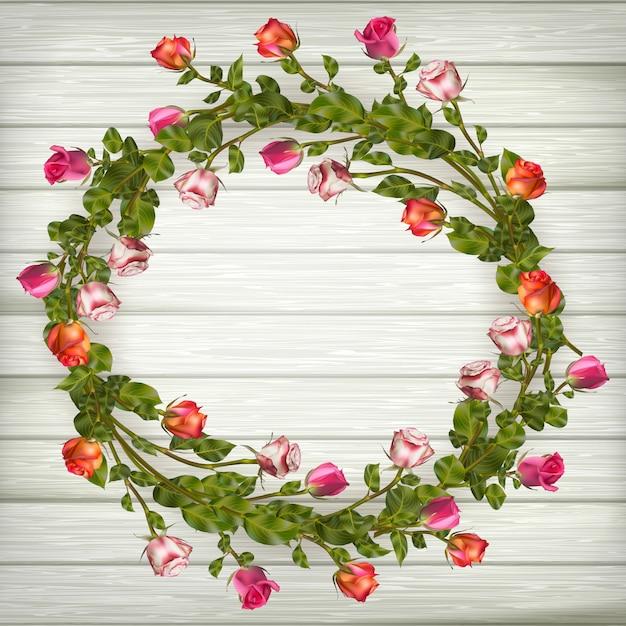 木製の背景にバラの花輪。含まれるファイル Premiumベクター