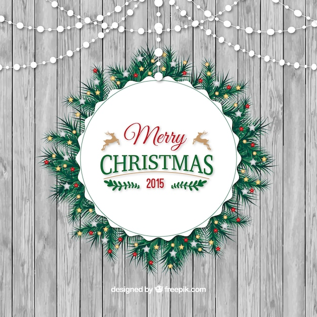 Rounded christmas wreath on a wood texture\ background
