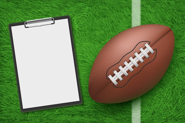 Rugby ball and clipboard lying on stadium green grass top view Free Vector