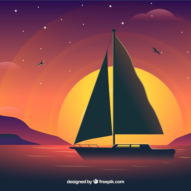 Sailing boat on sunset background