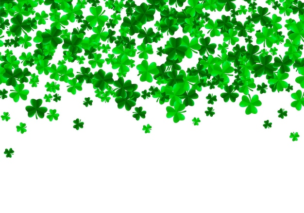 Saint patrick day background with green bright leaves of trefoil clover Premium Vector
