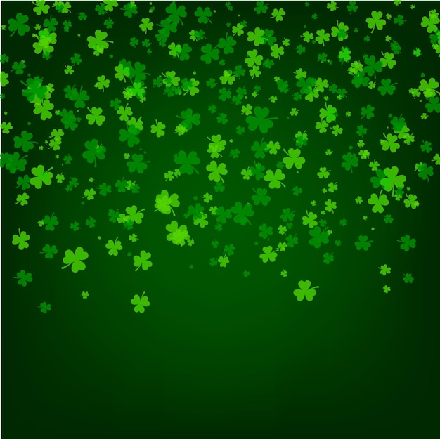 Saint patrick day background with green leaves of trefoil clover Premium Vector