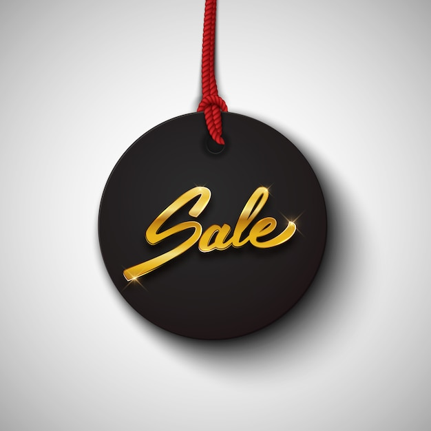 Sale black tag or label with gold text Premium Vector