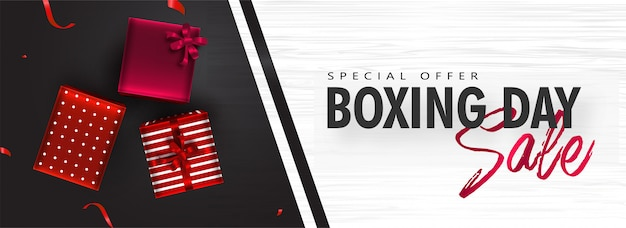 Sale header or banner with top view of gift boxes on black and white texture for boxing day. Premium Vector