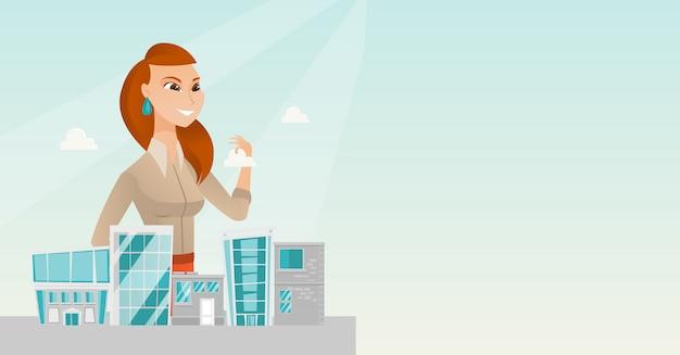 Sales manager presenting city model. Premium Vector