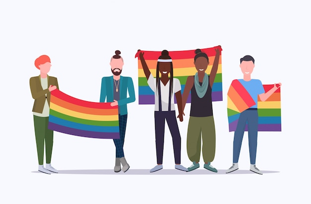 Same sex couples holding rainbow flag mix race lesbians gays celebrating love parade lgbt pride festival concept cartoon characters standing together full length flat horizontal Premium Vector