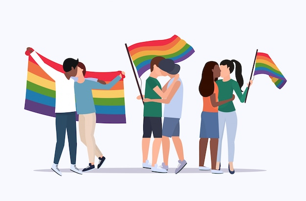 Same sex couples holding rainbow flag mix race lesbians gays kissing love parade lgbt pride festival concept cartoon characters standing together full length flat horizontal Premium Vector