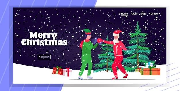 엘프 도우미 운동 건강한 라이프 스타일 크리스마스 휴일 축하 개념 방문 페이지와 권투 연습을 연습 산타 클로스 복서 프리미엄 벡터